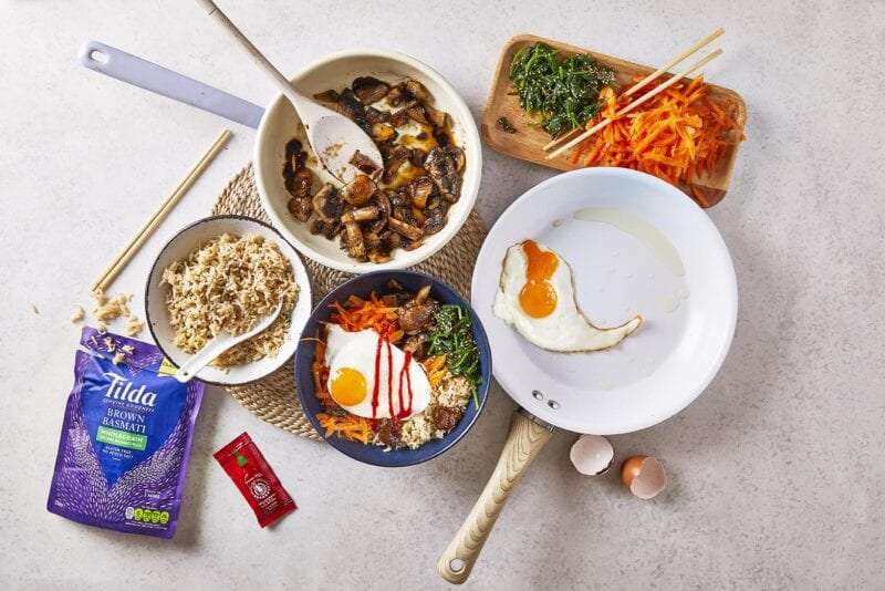 Bowlfuls of ingredients for Ten-Min Mushroom Bibimbap with Sriracha