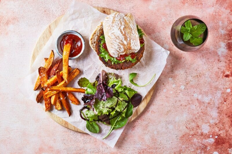 Lentil burger with sweet potato fries