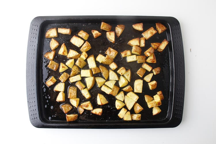 Cubed potatoes on baking tray